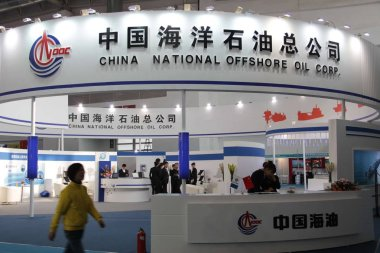 A visitor walks past the stand of CNOOC (China National Offshore Oil Corporation) during the 12th China International Petroleum & Petrochemical Technology and Equipment Exhibition, known as CIPPE 2012, in Beijing, China, 20 March 2012.