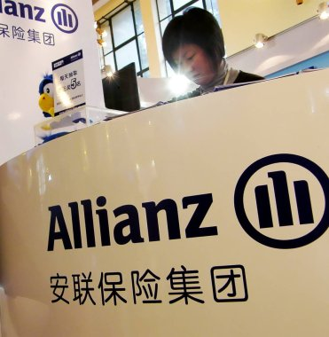 A Chinese employee of Allianz works at an exhibition in Shanghai, China, 22 November 2008