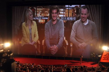 US actress Emma Stone, actor Andrew Garfield and director Marc Webb are live broadcast during the premiere for the movie, The Amazing Spider-man, at a cinema in Beijing, China, 26 August 2012.