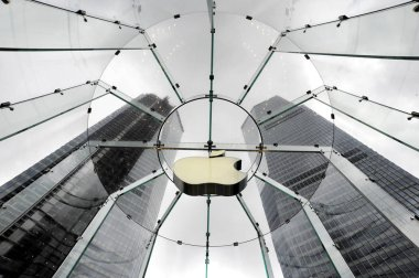 Worms eye view of the logo of Apple in the Apple Store next to Jinmao ifc (International Finance Centre) towers in the Lujiazui Financial District in Pudong, Shanghai, China, 31 August 2010