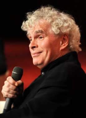 Sir Simon Rattle, principal conductor of the Berlin Philharmonic, speaks at a press conference for the Beijing concert of the Berlin Philharmonic on its Asian tour in Beijing, China, 9 November 2011