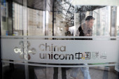 A Chinese man is seen at a branch of China Unicom in Shanghai, China, March 2, 2011