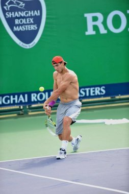 Spanish tennis player Rafael Nadal practises at a court preparing for Shanghai Masters in Shanghai, China, 10 October 2011.