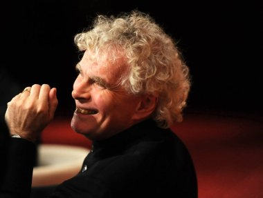 Sir Simon Rattle, principal conductor of the Berlin Philharmonic, attends a press conference for the Beijing concert of the Berlin Philharmonic on its Asian tour in Beijing, China, 9 November 2011