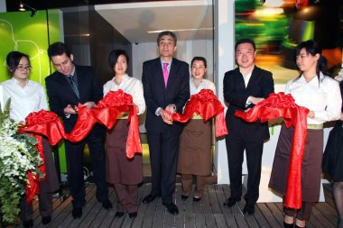 Mr. Alberto Fernandez, Everwines CEO(left), Mr. Carlos Pascual Pons, Spanish Commercial Consul (centre), Mr. Benny, Property developer (right) attend the opening ceremony of Everwines first shop in Shanghai, China, 21 April 2011