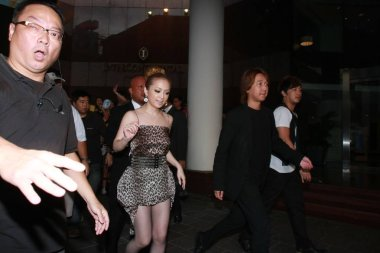 Japanese pop singer Ayumi Hamasaki leaves the hotel to go shopping for tea leaves in Hong Kong, China, 30 June 2010.