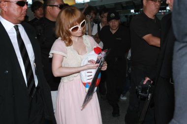 Japanese singer Ayumi Hamasaki arrives at the Hong Kong International Airport before leaving for Japan, 1 July 2010.