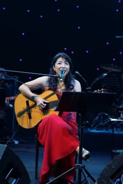 Japanese jazz singer Ono Lisa performs during her concert in Shanghai, China, 27 November 2011.