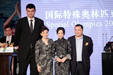 (From second left to right) Retired Chinese basketball superstar Yao Ming, Chinese TV hostess Yang Lan, Hong Kong actress Carina Lau and Bruno Wu, Co-Founder and Chairman of Sun Media Investment Holdings Limited, attend a charity banquet and auction