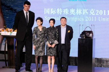 (From left) Retired Chinese basketball superstar Yao Ming, Chinese TV hostess Yang Lan, Hong Kong actress Carina Lau and Bruno Wu, Co-Founder and Chairman of Sun Media Investment Holdings Limited, attend a charity banquet and auction for the Special