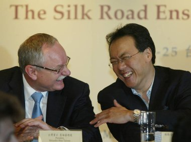 Renowned cellist Yo-Yo Ma (R) chats with Wolfram Geisler, President and CEO of Mercedes-Benz Taiwan, during a press conference for his upcoming concerts in Taipei, Taiwan, April 21, 2010