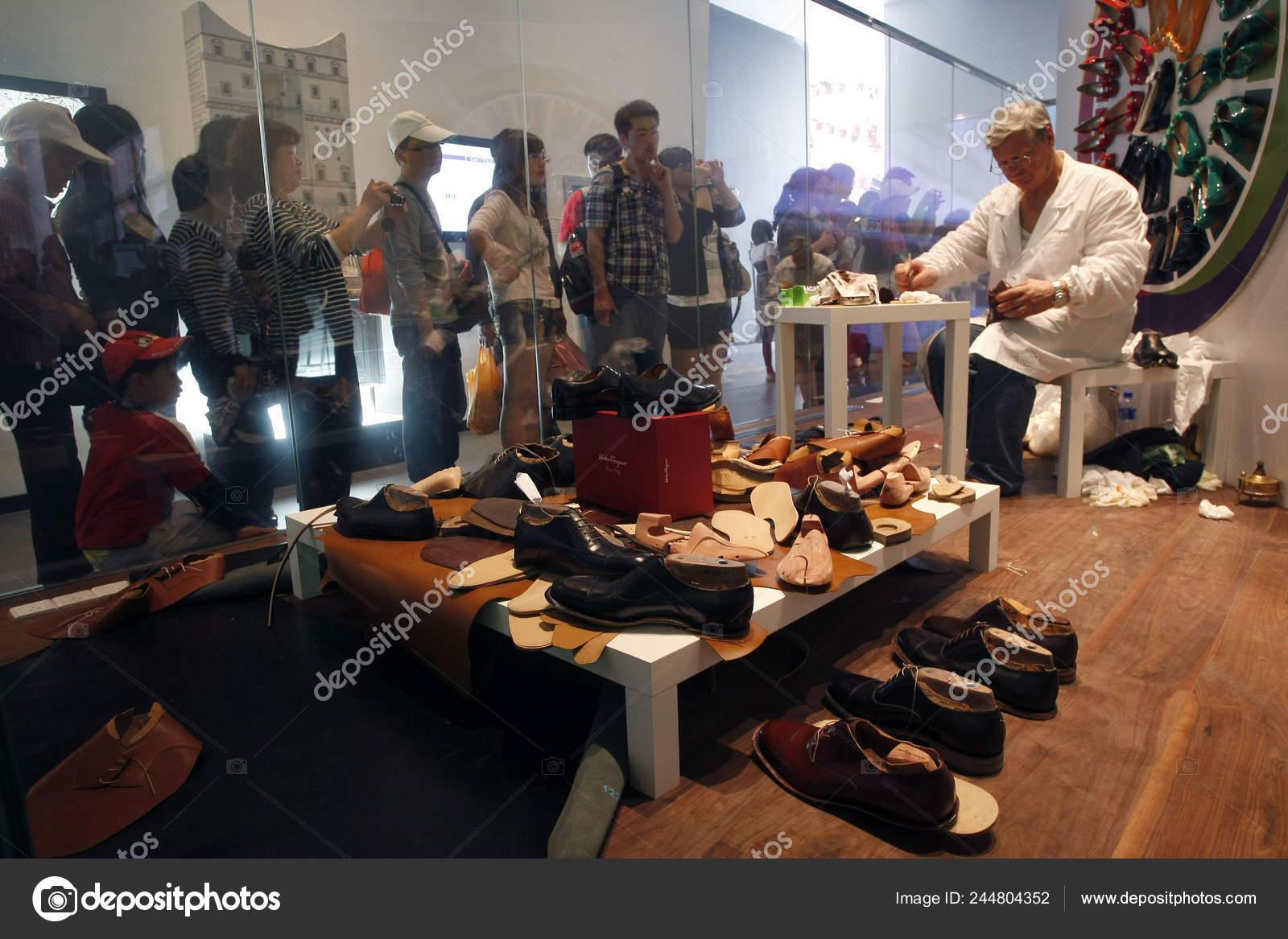 Visitors Watch Italian Shoemaker
