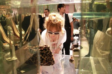 Japanese pop singer Ayumi Hamasaki is seen shopping in a boutique in Admiralty in Hong Kong, China, 29 June 2010.