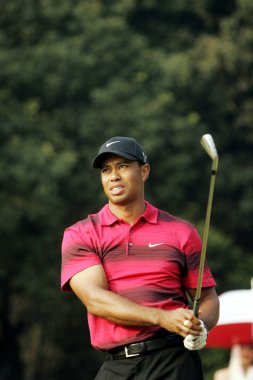US golfer Tiger Woods hits a ball during the final round of the HSBC Champions golf tournament at the Sheshan International Golf Club in Shanghai, China, 7 November 2010