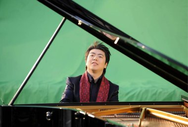 Chinese pianist Lang Lang performs during the production of the MV for the song, Nation, marking the 60th anniversary of the founding of the Peoples Republic of China, in Beijing, China, March 8, 2009.