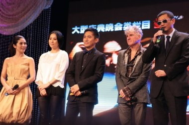 ( L to R ) Hong Kong actress Charlie Yeung, actress Carina Lau, actor Tony Leung, Australian cinematographer Christopher Doyle, and Hong Kong film director Wong Kar Wai are seen during a TV programme for the movie Ashes of Time Redux in Beijing, Chin