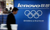A Chinese man walks past an advertisement of Lenovo in Xiamen, southeast Chinas Fujian province, March 15, 2009