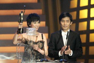 Hong Kong actress Carina Lau and actor Tony Leung present the Best Film Award at the 26th Hong Kong Film Awards, 15 April 2007.
