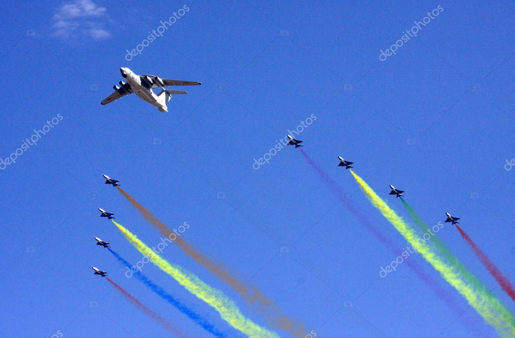 Chinese military jets of PLA (Peoples Liberation Army) fly over the Tiananmen Square during a military parade of the grand celebration for the 60th anniversary of the founding of the Peoples Republic of China, in Beijing, China, Thursday, 1 October 2
