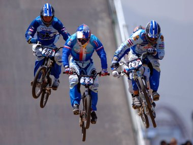 BMX cyclists take a jump during the mens quarterfinal of the Good Luck Beijing 2007 UCI BMX Supercross World Cup in Beijing 21 August 2007. Donny Robinson of the US won the mens event of the BMX Supercross World Cup.