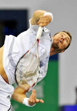 Marat Safin of Russia competes against Chinas Gong Maoxin during the first round of the 2009 Shanghai ATP Masters 1000 tennis tournament in Shanghai, China, 12 October 2009