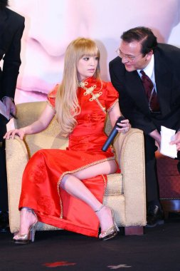 Japanese pop singer Ayumi Hamasaki (left) at a media event to promote her Shanghai concert in Shanghai, April 20, 2007