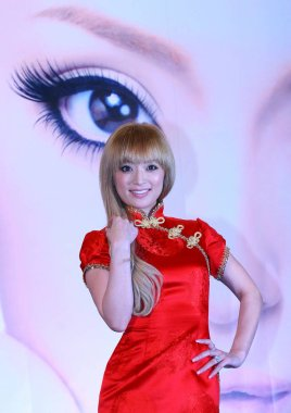 Japanese pop singer Ayumi Hamasaki poses for photos at a media event to promote her Shanghai concert in Shanghai, April 20, 2007