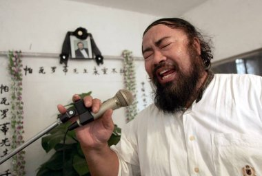 Mr. Jin, 52, sings during a memorial meeting for the death of Italian Tenor Luciano Pavarotti at his house in Tianjin 6 September 2007