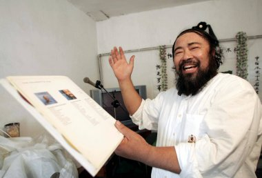 Mr. Jin, 52, shows the collections of Italian tenor Luciano Pavarotti and sings during a memorial meeting for the death of Pavarotti at his house in Tianjin 6 September 2007