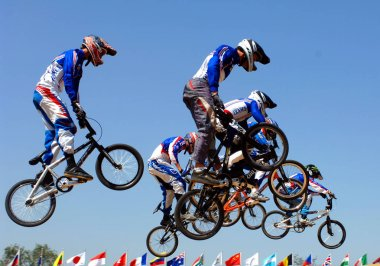 BMX cyclists take a jump during the mens semi-final of the Good Luck Beijing 2007 UCI BMX Supercross World Cup in Beijing 21 August 2007. Donny Robinson of the US won the mens event of the BMX Supercross World Cup.