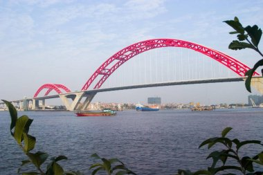View of Xin Guang Bridge which is a 3 span continuous arch bridge with the longest centre span in the world and sightseeing elevators  installed at both ends of the bridge in Guangzhou, capital of south Chinas Guangdong province, January 2007