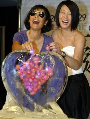 Taiwanese singer Rene Liu and Taiwanese director and singer Sylvia Chang during a promotional event for Lius upcoming concert in Taiwan, September 10, 2008.