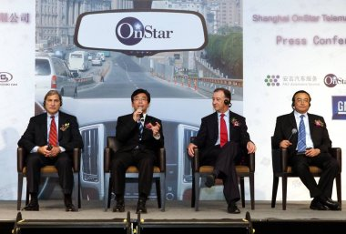 (From L) Chet Huber, President of OnStar Corporation, Ding Lei, General Manager of Shanghai GM, Kevin Wale, President of General Motors China, and Xu Deping, Managing Director of Shanghai Automotives sales arm, during a press conference to announce t stock vector