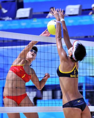 Chinas Xue Chen smashes the ball against Chinas Wang Jie during a semifinal match of womens beach volleyball, at Beijing 2008 Olympic Games, at Beijings Chaoyang Park Beach Volleyball Ground, in Beijing, August 19, 2008.