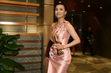 Hong Kong actress Carina Lau, winner of the best actress, poses during the closing ceremony of Golden Rooster and Hundred Flowers Film Festival, in Suzhou, east Chinas Jiangsu province, October 27, 2007.