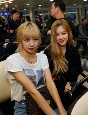 Lisa and Rose of South Korean girl group Blackpink are pictured after landing at the airport in Taipei, Taiwan, 2 March 2019.