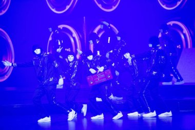 Members of American hip-hop dance crew Jabbawockeez perform during their first ever Macau residency show at the MGM Cotai hotel in Macau, China, 2 March 2019