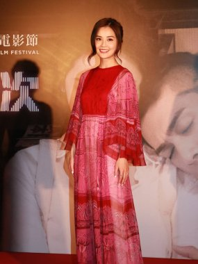 Singer and actress Charlene Choi of Hong Kong pop duo Twins arrives at a premiere for her movie