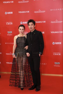 Hong Kong actress Carina Lau and Taiwanese-Canadian actor Mark Chao pose as they arrive on the red carpet for the opening ceremony of the 21st Shanghai International Film Festival in Shanghai, China, 16 June 2018.