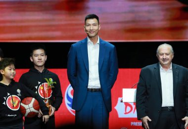Chinese basketball player Yi Jianlian, tallest, attends the draw ceremony for the 2019 FIBA Basketball World Cup in Shenzhen city, south China's Guangdong province, 16 March 2019.