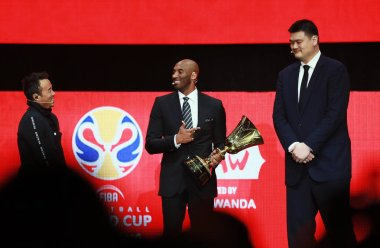 Former NBA basketball player and FIBA World Cup Ambassador Kobe Bryant, center, Retired Chinese basketball star Yao Ming, tallest, chairman of the Chinese Basketball Association attend the draw ceremony for the 2019 FIBA Basketball World Cup in Shenz