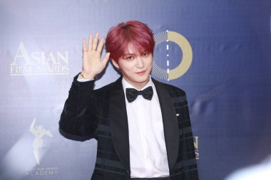 South Korean singer and actor Kim Jae-joong poses as he arrives on the red carpet for the 13th Asia Film Awards in Hong Kong, China, 17 March 2019.
