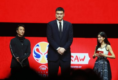 Retired Chinese basketball star Yao Ming, tallest, chairman of the Chinese Basketball Association attends the draw ceremony for the 2019 FIBA Basketball World Cup in Shenzhen city, south China's Guangdong province, 16 March 2019.