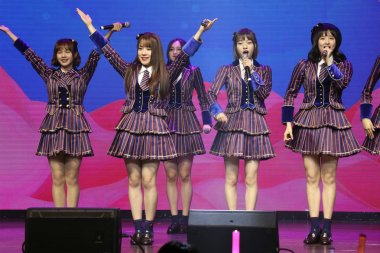 Members of Chinese girl idol group AKB48 Team SH perform at their first fan meeting in Shanghai, China, 23 March 2019.