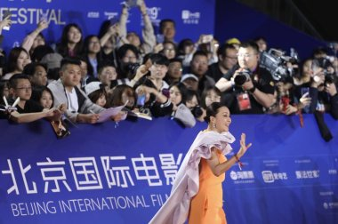 Hong Kong actress Carina Lau poses as she arrives on the red carpet for the 9th Beijing International Film Festival 2019 in Beijing, China, 13 April 2019.