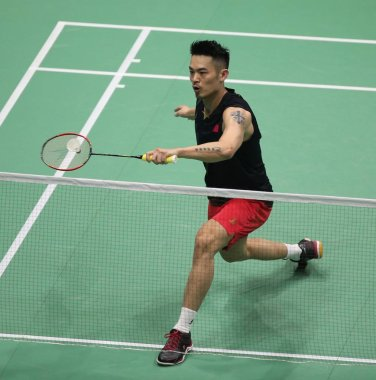 Lin Dan of China returns a shot to Lu Chia-hung of Chinese Taipei in their first round match of men's singles during the 2019 Badminton Asia Championships in Wuhan city, central China's Hubei province, 24 April 2019