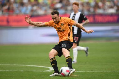 Portuguese football player Diogo Jota of Wolverhampton Wanderers F.C. of English League champions shots the ball against Newcastle United F.C. in the semifinal match during the Premier League Asia Trophy 2019 in Nanjing city, east China's Jiangsu pro
