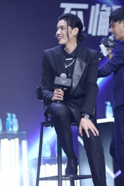 Chinese-Canadian actor, rapper, singer, record producer, and model Kris Wu attends an activity of anti-dandruff shampoo brand CLEAR, dressing in black suit, Shanghai, China, June 10 2020.