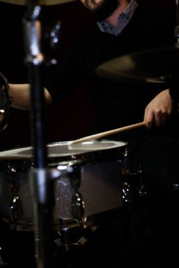 partial view of man playing drums