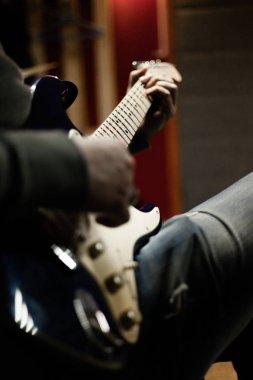 man plays guitar in rehearsal